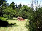 Private BBQ / braai area which is lit at night of Lothlorien Cottage in Hogsback, South Africa